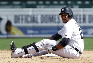 Photo - Detroit Tigers' Miguel Cabrera grabs his leg after being tagged out sliding into second base against the Oakland Athletics in the fifth inning of a baseball game in Detroit, Thursday, Aug. 29, 2013. Cabrera left the game. (AP Photo/Paul Sancya)