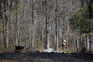 Photo - Workers clean up oil in Mayflower, Ark., on Monday, April 1, 2013, days after a pipeline ruptured and spewed oil over lawns and roadways. (AP Photo/Jeannie Nuss)