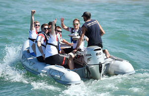 Photo - German national soccer players Bastian Schweinsteiger, background left, goalkeeper Ron-Robert Zieler, Per Mertesacker and Benedikt Hoewedes, right, ride in a boat in Santo Andre near Porto Seguro, Brazil, Tuesday, June 10, 2014. The German team got some motivation help from explorer and adventurer Mike Horn during a sailing outing near their camp on Brazil's Atlantic coast. (AP Photo/Markus Gilliar, pool)