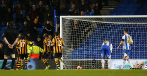 Photo - Hull City's Yannick Sagbo, number 20, celebrates his equalizing goal against Brighton and Hove Albion during their FA Cup fifth round soccer match at the AMEX Stadium, Brighton, England, Monday, Feb. 17, 2014. (AP Photo/Chris Ison, PA Wire)    UNITED KINGDOM OUT   -   NO SALES   -   NO ARCHIVES