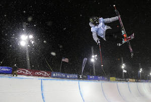 Photo - Brita Sigourney flies above the lip of the halfpipe during the World Cup U.S. Grand Prix halfpipe freestyle skiing finals on Friday, Dec. 20, 2013, in Frisco, Colo. Sigourney took first place in the event. (AP Photo/Julie Jacobson)