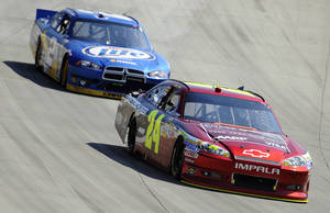 Photo -   Jeff Gordon, front, and Brad Keselowski, back, compete during a NASCAR Sprint Cup Series auto race, Sunday, Sept. 30, 2012, at Dover International Speedway in Dover, Del. Keselowski went on to win and Gordon finished second. (AP Photo/Nick Wass)
