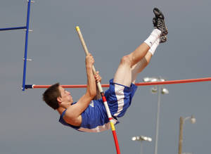 Photo - HIGH SCHOOL TRACK AND FIELD: Lane Wilhite, of Covington Douglas High School, participates in boys Class A pole vaulting during a track meet at Carl Albert High School in Midwest City, Friday, May 4, 2012.  Photo by Garett Fisbeck, For The Oklahoman