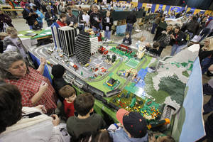 Photo - Hundreds of people watch the model trains pass by during the 2010 Oklahoma City Train Show in the Travel and Transportation Building at State Fair Park in Oklahoma City. PHOTO BY PAUL HELLSTERN, THE OKLAHOMAN ARCHIVES