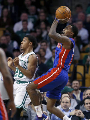 Photo - Detroit Pistons point guard Brandon Jennings (7) shoots over Boston Celtics point guard Phil Pressey (26) in the second half of an NBA basketball game in Boston, Wednesday, Dec. 18, 2013. The Pistons won 107-106.  (AP Photo/Elise Amendola)