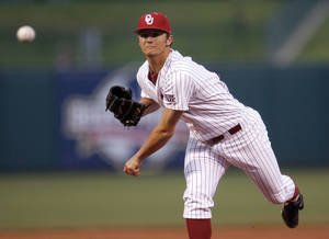 photo - UNIVERSITY OF OKLAHOMA / COLLEGE BASEBALL: OU&#039;s Jordan John throws a pitch during their Big 12 tournament game between Oklahoma and Kansas State at RedHawks Field at Bricktown in Oklahoma City, Wednesday, May 25, 2011. Photo by Sarah Phipps, The Oklahoman ORG XMIT: KOD