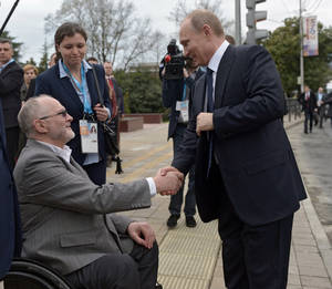 Photo - Russian President Vladimir Putin, right,  shakes hands with International Paralympic Committee President Philip Craven while visiting city facilities in Sochi, Russia, Friday, March 7, 2014. The opening ceremony of the 2014 Winter Paralympics is held in Sochi on Friday. (AP Photo/RIA-Novosti, Alexei Nikolsky, Presidential Press Service)