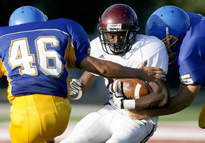 photo - Edmond Memorial will look to D'Juan Broooks, center, out of the backfield. Photo by Bryan Terry, The Oklahoman