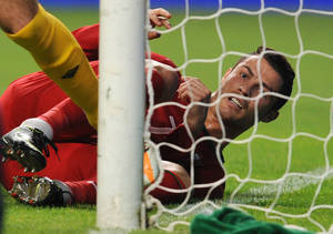 Photo -   Portugal's Cristiano Ronaldo reacts after missing a shot against Azerbaijan during their World Cup 2014 Group F qualifying soccer match in Braga, Portugal, Tuesday, Sept. 11, 2012. (AP Photo/Paulo Duarte)