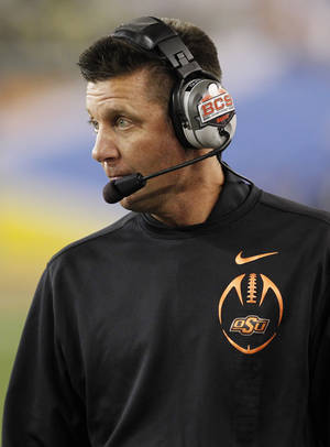 photo - Oklahoma State head coach Mike Gundy watches his team from the sidelines during the second half of the Fiesta Bowl NCAA college football game against Stanford Monday, Jan. 2, 2012, in Glendale, Ariz. (AP Photo/Ross D. Franklin)