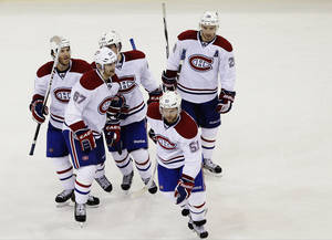 Photo - Montreal Canadiens' Max Pacioretty (67) celebrates with Brandon Prust (8), Raphael Diaz (61), Josh Gorges (26) and David Desharnais (51) and after scoring a goal during the second period of an NHL hockey game against the New York Rangers, Tuesday, Feb. 19, 2013, in New York. (AP Photo/Frank Franklin II)