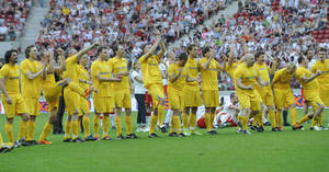photo -   Members of the Ukrainian team react after Polish and Ukrainian celebrities played a friendly soccer match at the National Stadium in Warsaw, Poland, Sunday, April 29, 2012. The game was the last event at the site before the opening of the Euro 2012 soccer championships, which will open in this stadium. (AP Photo/Alik Keplicz)
