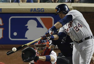 Photo - American League's Miguel Cabrera, of the Detroit Tigers, hits a double during the third inning of the MLB All-Star baseball game, on Tuesday, July 16, 2013, in New York. (AP Photo/Frank Franklin II)