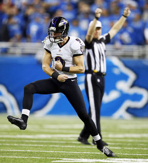 Photo - Baltimore Ravens kicker Justin Tucker (9) celebrates after his 61-yard field during the fourth quarter of an NFL football game against the Detroit Lions in Detroit, Monday, Dec. 16, 2013. (AP Photo/Rick Osentoski)
