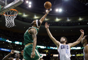 Photo - Boston Celtics' Chris Wilcox, center left, reaches for a rebound in front of Charlotte Bobcats' Josh McRoberts (11) in the first quarter of an NBA basketball game in Boston, Saturday, March 16, 2013. (AP Photo/Michael Dwyer)