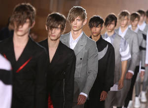 Photo - Models wear creations by Alexander McQueen during London Men's spring summer fashion collections 2015, at the Royal College of Surgeons of England by Lincoln's Inn Fields, central London, Monday, June 16, 2014. (Photo by Joel Ryan/Invision/AP)