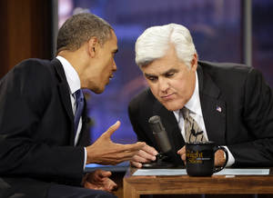 Photo -   President Barack Obama, right, talks with Jay Leno, right, during a commercial break during the taping of his appearance on NBC's The Tonight Show with Jay Leno, Wednesday, Oct. 24, 2012, in Burbank, Calif. (AP Photo/Pablo Martinez Monsivais)