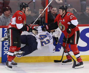 Photo - Ottawa Senators Zack Smith (15) and Chris Neil (25) check St.Louis Blues David Backes (42) during first period NHL hockey action in Ottawa Monday, Dec. 16, 2013. (AP Photo/The Canadian Press, Fred Chartrand)