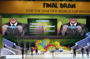Photo - FIFA Secretary General Jerome Valcke holds the ticket of the Netherlands during the draw ceremony for the 2014 soccer World Cup in Costa do Sauipe near Salvador, Brazil, Friday, Dec. 6, 2013. (AP Photo/Silvia Izquierdo)