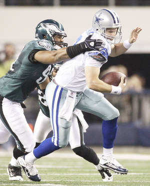 Photo - Cowboys quarterback Jon Kitna, right, is sacked by the Eagles' Ricky Sapp on Sunday. AP photo