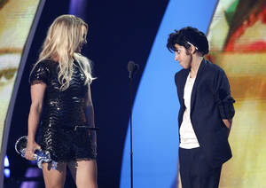 Photo - Lady Gaga, right, presents Britney Spears with the Video Vanguard award at the 2011 MTV Video Music Awards.  AP File Photo