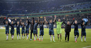 Photo - Bayern's team celebrates after winning the  quarterfinal match of the German soccer cup between Hamburger SV and Bayern Munich in Hamburg, Germany, Wednesday, Feb. 12, 2014. Bayern won 5-0. (AP Photo/Martin Meissner)