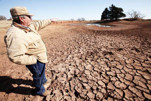 photo - Drought conditions. Logan County rancher John Pfeiffer describe what this ponds water level should be, Wednesday, November 28, 2012.  Photo By David McDaniel/The Oklahoman