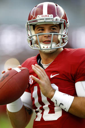 Photo - Alabama quarterback AJ McCarron (10) throws a pass before the first half of an NCAA college football game against Arkansas on Saturday, Oct. 19, 2013, in Tuscaloosa, Ala. (AP Photo/Butch Dill)