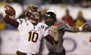 Photo - Arizona State quarterback Taylor Kelly (10) throws a pass while playing Texas Tech in the second half during the Holiday Bowl NCAA college football game Monday, Dec. 30, 2013, in San Diego. (AP Photo/Gregory Bull)