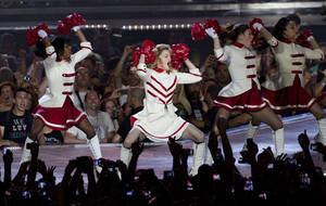 photo -   U.S pop icon Madonna performs at the Ramat Gan stadium near Tel Aviv, Israel,Thursday, May 31, 2012. Pop music star Madonna is kicking off her new world tour in front of tens of thousands of ecstatic fans in Israel. (AP Photo/Ariel Schalit)