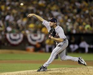 Photo - Detroit Tigers pitcher Justin Verlander throws a pitch in the fourth inning of Game 2 of an American League baseball division series against the Oakland Athletics in Oakland, Calif., Saturday, Oct. 5, 2013. (AP Photo/Ben Margot)