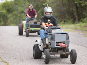 Photo - Don Fish, in front, and his brother Joe get ready for the lawnmower races in Jones.  Photo by David McDaniel, The Oklahoman <strong>David McDaniel - The Oklahoman</strong>