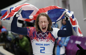 Photo - Elizabeth Yarnold of Britain celebrates her gold medal win during the women's skeleton competition at the 2014 Winter Olympics, Friday, Feb. 14, 2014, in Krasnaya Polyana, Russia. (AP Photo/Michael Sohn)