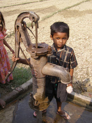 A boy poses beside a water well in India, the first country visited by World Neighbors. The group's work in this South Asian nation includes increasing access to community and reproductive services, implementing low cost and environmentally friendly agricultural practices and increasing access to water and basic sanitation, among others.