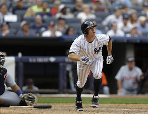 Photo - New York Yankees' Brett Gardner watches his ninth-inning solo home run off Detroit Tigers relief pitcher Jose Veras in a baseball game on Sunday, Aug. 11, 2013, in New York. The Yankees won 5-4. (AP Photo/Kathy Willens)