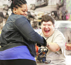 Photo - Barb Horton, a client, enjoys music time and looks forward to the chance to dance with staff member Ebony Hood at the Oklahoma Foundation for the Disabled.  It was also Horton's birthday.   Photo by Jim Beckel, The Oklahoman <strong>Jim Beckel - THE OKLAHOMAN</strong>