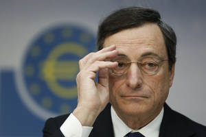 photo - The President of the European Central Bank, ECB, Mario Draghi, speaks during a press conference in Frankfurt, central Germany, Thursday Dec. 6, 2012. The European Central Bank left rates unchanged at its meeting Thursday, and Mario Draghi gave little sign the bank was willing to add more stimulus. He said the bank had already done much to lower borrowing costs in heavily indebted countries that are struggling to grow. (AP Photo/dapd/ Alex Domanski)