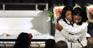 Photo - Family members mourn next to the casket of 6-month old Jonylah Watkins during her funeral at New Beginnings Church in Chicago, Tuesday, March, 19, 2013.  Watkins was killed when a gunman fired at a minivan as she sat on her father's lap on March11.  (AP Photo/Paul Beaty)