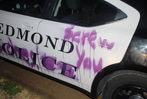 Photo - An Edmond police car was hit twice by vandals who left messages on the city-owned vehicle. PHOTO PROVIDED, EDMOND POLICE DEPARTMENT. <strong>PROVIDED</strong>