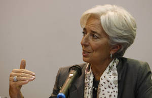 photo - The Managing Director of the International Monetary Fund (IMF) Christine Lagarde gestures during a press conference in Bogota, Colombia, Tuesday, Dec. 11, 2012. Lagarde is in Colombia on a two day visit during which she will meet with Colombia's President Manuel Santos and members of his economic team, before traveling to Chile for an economic conference. (AP Photo/William Fernando Martinez)