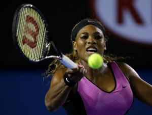Photo - Serena Williams of the United States hits a forehand return to Ashleigh Barty of Australia during their first round match at the Australian Open tennis championship in Melbourne, Australia, Monday, Jan. 13, 2014.(AP Photo/Aaron Favila)