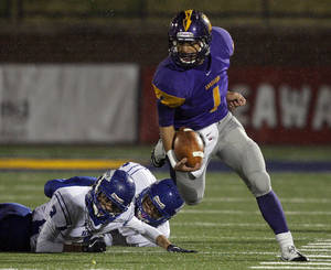 Photo - Anadarko's Sheldon Wilson gets by Berryhill's Justin Jackson, left, and Trey Jimenez during the 3A semifinal of high school football championships between Anadarko and Berryhill at Wantland Stadium in Edmond, Okla.,Friday, Dec. 2, 2011.  Photo by Sarah Phipps, The Oklahoman