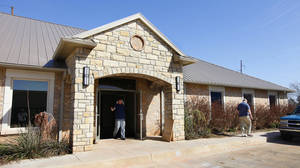 photo - Edmond information technology employees move into their new building at 1273 N Broadway.
