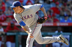 Photo - Texas Rangers relief pitcher Joe Nathan delivers in the ninth inning to defeat the Los Angeles Angels 4-3 during a baseball game Sunday, Sept. 8, 2013, in Anaheim, Calif. (AP Photo/Alex Gallardo)