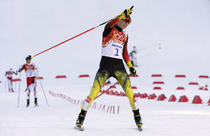 Photo - Germany's Eric Frenzel celebrates winning the gold after the cross-country portion of the Nordic combined at the 2014 Winter Olympics, Wednesday, Feb. 12, 2014, in Krasnaya Polyana, Russia. (AP Photo/Matthias Schrader)