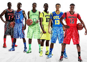 Photo - This undated image provided by Adidas shows models wearing new college basketball uniforms for, from left, Cincinnati, Kansas, Notre Dame, Baylor, UCLA and Louisville. (AP Photo/Adidas) ORG XMIT: NY153