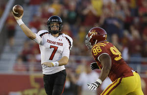 photo -   Texas Tech quarterback Seth Doege, left, passes over Iowa State defensive lineman Henry Simon during the first half of an NCAA college football game, Saturday, Sept. 29, 2012, in Ames, Iowa. (AP Photo/Charlie Neibergall)