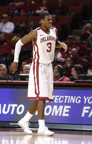 photo - Oklahoma guard Buddy Hield (3) hobbles off the court after injuring his right foot in the second half of an NCAA college basketball game against TCU in Norman, Okla., Monday, Feb. 11, 2013. Oklahoma won 75-48.(AP Photo/Sue Ogrocki) ORG XMIT: OKSO112