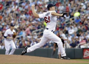 Photo - Minnesota Twins pitcher Andrew Albers  throws against the Cleveland Indians in the first inning of a baseball game, Monday, Aug. 12, 2013 in Minneapolis. (AP Photo/Jim Mone)