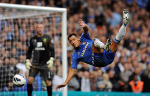 Photo -   Chelsea's John Terry in action during the English Premier League soccer match against Norwich City at Stamford Bridge, London, Saturday Oct. 6, 2012. Chelsea won the match 4-1. (AP Photo/PA, Andrew Matthews) UNITED KINGDOM OUT NO SALES NO ARCHIVE